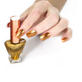 Golden nail polish Stock Photos
