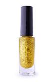 Golden nail polish with glitter Stock Images