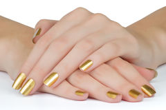 Golden nails Royalty Free Stock Images