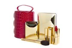 Golden nameless woman cosmetics. On white background stock photos