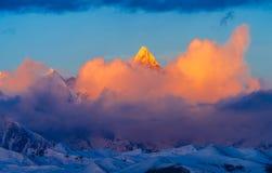 Golden Namjagbarwa mountain in Tibet. Golden peak in sunset, Namjagbrawa peak is the highest mountain in Tibet Chinese Linzhi area, 7782 meters above sea level stock images