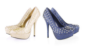 Golden and navy blue glitter spiked shoes stock photos