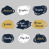 Golden, navy blue, and white irregular shapes stickers set Royalty Free Stock Images