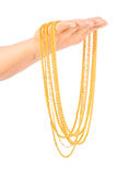 Golden necklace Stock Images