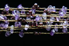 Golden necklace with amethyst stones Royalty Free Stock Images