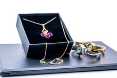 Golden necklace in a box and two beautiful watches Royalty Free Stock Photos