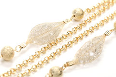 Golden necklace. Closeup photo of necklace with over white Stock Image