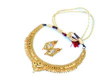 Golden necklace and ear-rings jewellery Stock Image