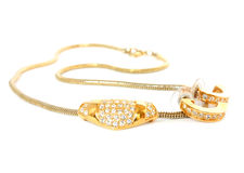 Golden necklace and earrings Stock Images