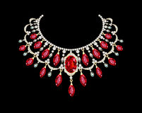 Golden necklace  female with red precious stones Royalty Free Stock Images