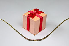 Golden necklace with gift Royalty Free Stock Image