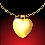 Golden necklace with glossy heart Stock Photos