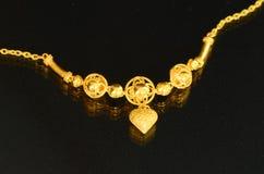 Golden necklace. Stock Photos