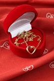 Golden necklace with heart Royalty Free Stock Image