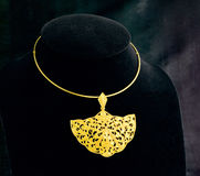 Golden necklace with pendant Royalty Free Stock Photos