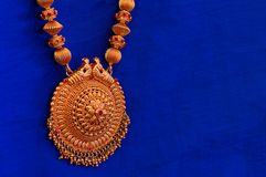 A golden necklace, Pune. Close view of A golden necklace, Pune Royalty Free Stock Images
