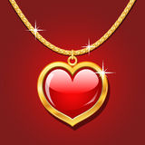 Golden necklace with ruby heart Royalty Free Stock Images