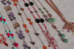 Golden necklaces and gemstones for sale at flea market Royalty Free Stock Photo
