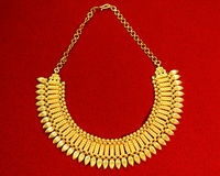 Golden neclace. With golden chain on red background Stock Images