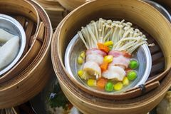 Golden Needle Mushroom with Bacon in Various Dim Sum on the Tabl. E, Steamed Traditional Chinese Cuisine Food Stock Images