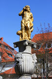 Golden neptune fountain Stock Photos