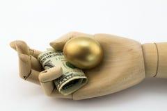Golden nest egg metaphor Stock Image