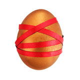 Golden nest egg tied up in red tape - financial concept Royalty Free Stock Photo