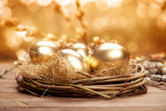 Golden nest eggs Stock Image