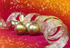 Golden New Year's balls and ribbon Royalty Free Stock Photo