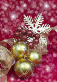 Golden New Year's balls and ribbon Stock Photo