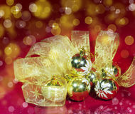Golden New Year's balls and ribbon Royalty Free Stock Images