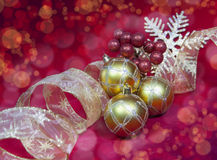 Golden New Year's balls and ribbon Stock Images