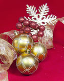 Golden New Year's balls and ribbon on a red background Stock Photo
