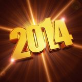 Golden new year 2014 with shining rays over brown background Royalty Free Stock Photos