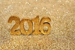 Golden 2016 new years numbers on gold background Royalty Free Stock Image