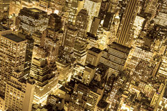 Golden New York City Lights. Golden cityscape of New York City buildings and lights at night Stock Photo