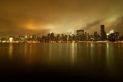 Golden new york city skyline. A shot of new york city skyline at night Royalty Free Stock Photos