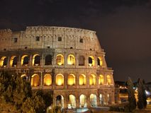 Golden night view of The Colosseum in Rome Royalty Free Stock Photo