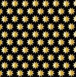 Golden nine pointed star on black background Stock Photo