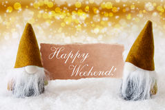 Golden Noble Gnomes With Card, Text Happy Weekend. Christmas Greeting Card With Two Golden Gnomes. Sparkling Bokeh And Noble Background With Snow. English Text Royalty Free Stock Image