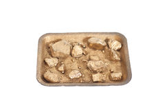 Golden nuggets on grungy wash pan with sand isolated Royalty Free Stock Image