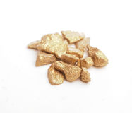 Golden nuggets on white Royalty Free Stock Image