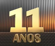 Golden number eleven number 11 and the word. `years` against the background of metal rectangular parallelepipeds in the rays of sunset.  Translated from the Royalty Free Stock Photography