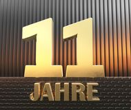 Golden number eleven number 11 and the word. `years` against the background of metal rectangular parallelepipeds in the rays of sunset.  Translated from the Royalty Free Stock Photo