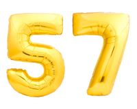 Golden number 57 fifty seven made of inflatable balloon. Isolated on white background Stock Photos