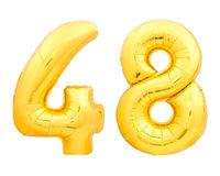 Golden number 48 fourty eight made of inflatable balloon on white. Golden number 48 fourty eight made of inflatable balloon isolated on white background Royalty Free Stock Photo