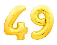 Golden number 49 fourty nine made of inflatable balloon on white. Golden number 49 fourty nine made of inflatable balloon isolated on white background Royalty Free Stock Photos