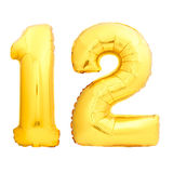 Golden number 12 made of inflatable balloon Stock Photography