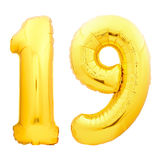 Golden number 19 nineteen made of inflatable balloon. Isolated on white background Stock Photography