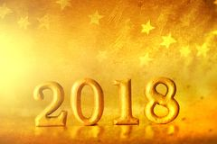 Golden Number 2018 placed on gold elegant glamour star tone bac Royalty Free Stock Photo